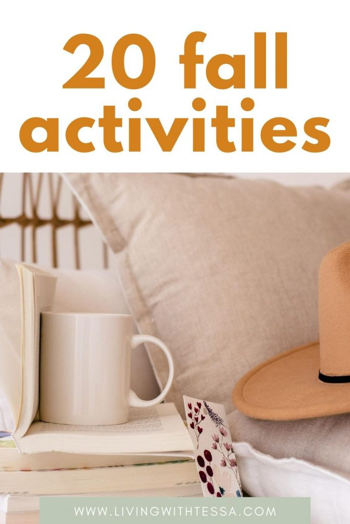 Pin image for article things to do in fall. Picture of a stack of books with a mug on top of it. to the right if that, a beige pillow and a hat.